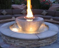 Gorgeous stone fountain with fire feature.