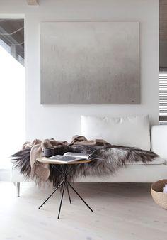 gray sheepskin throw on white sofa / sfgirlbybay