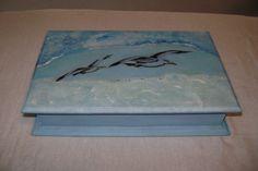 caja    un  poco  de mar  y   gaviotas