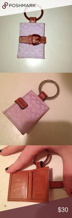 Coach key chain Off white color with lilac C logo, can put pictures in the slots on the inside, button close with brown belt detail. Excellent condition, no stains or marks! Coach Accessories