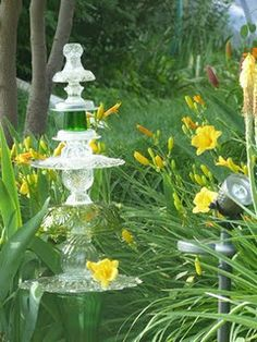 I have been collecting glassware at the Thrift Store ever since I was inspired by a photo of a glass garden totem.