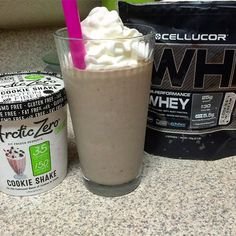 """Guiltless dessert! The hubby's next to me digging into some Ben & Jerrys Core ice Cream and I wanted something almost as good, but with less calories. So I mixed two servings of @arcticzero Cookie Shake with 4oz FF milk and a serving of @cellucor Cookies n Cream Whey Protein. Topped with FF Redi Whip."