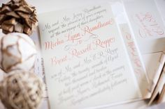 pink calligraphy wedding invites