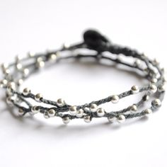 Beaded sterling silver bracelet. Triple wrap  bracelet or Necklace with sterling silver and Charcoal Gray Irish Linen Cord. $78.00, via Etsy.