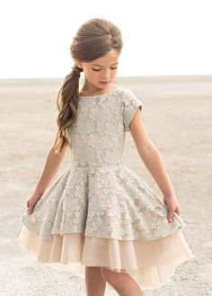 Etta Dress in Champagne | Perfect for holiday occasions, this lovely little dress features a luxe lace texture and subtle bead detailing at the neck. With such a beautiful and full skirt, this classy dress will please any fashionista!