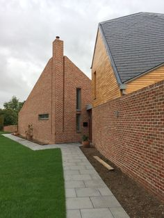 Modern home by KFM Architecture Brick Architecture, Concept Architecture, Sustainable Architecture, Social Housing, House On A Hill, Building A House, Build House, New Builds, Modern