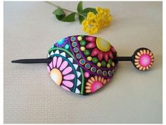 Visit the vibrance of spring with this hair slide by Kathy of Flowertown Originals on Etsy. The jellyroll canes really make this glow. Be illuminated with information and inspiration at The Polymer Arts magazine blog, http://www.thepolymerarts.com/blog/10156
