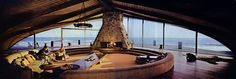 """""""American architect Harry Gesner loved the ocean and was a devoted longboard surfer and these passions were never better reflected than in his """"Cooper Residence"""". Built on the beach of Malibu, California and completed in 1957 the arched, shell-form roof lines of this home are glass fronted offering spectacular views of the Pacific Ocean."""""""