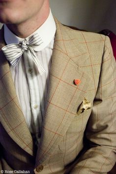 Style Snapshot: Mini Bout - a flower lapel pin stands in as the smallest boutonniere ever. #groom #fashion #mens