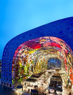 Rotterdam, The Netherlands, MVRDV, 2014 A dazzling mural of Technicolor flora and fauna (by local artists Arno Coenen and Iris Roskam) festoons the interior of this horseshoe-shaped marketplace and apartment complex, conceived by the Dutch firm MVRDV. The central bazaar is home to 96 food and flower vendors, while the surrounding structure houses a number of restaurants and shops in its base. Contained in the floors above are 228 apartments, most of which feature kitchens and dining rooms…