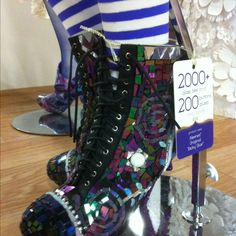 The coolest mosaic boots made by EcoHeidi Borchers. Over 2000 pieces of mosaic tiles, buttons and baubles :) At the iLovetoCreate booth at CHA W12.