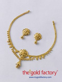 A mildly embellished x-phul chain with a heart-petalled flower in the centre from which dangles a conical half-jhumka. That's all there is to this lightweight beauty in hallmarked 22K gold, and that's all that's needed. Look glamorous in gold this season with sparkling specials from The Gold Factory
