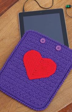 """Crocheted iPad Case - 8""""x10"""", 2 skeins yarn, size I crochet hook, two buttons and thread. Rated easy."""