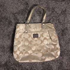 Used coach purse Previously loved, price reflects the markings and wear, few pen marks which are photographed and slight discoloring throughout the inside and outside, still extremely functional and zippers work, no holes, pockets on the inside, authentic, open to reasonable offers, no trades Coach Bags Shoulder Bags