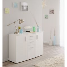 Store your extra dinnerware, flatware, and table linens in a buffet table or sideboard. Pull Out Drawers, Komodo, Sideboard Buffet, Table Linens, Storage Spaces, Nightstand, Cabinet, Room, Furniture