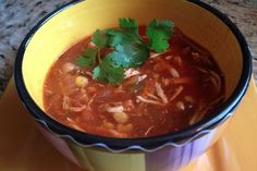 Slow Cooker Chicken Tortilla Soup - A soup that keeps on giving!  The longer it cooks the better the flavor!  www.GetCrocked.com