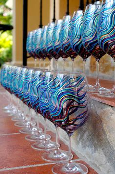 Cool peacock painted wine glasses. Painting anything on wine glasses would make a unique take-home-wedding-gift for the guests and yourself (: I would have soo much fun!