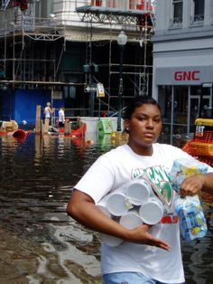 An unidentified woman I saw carrying baby formula on a flooded Canal street. Some looted for gain, but many were just trying survive. (Jason Sickles/Yahoo News)