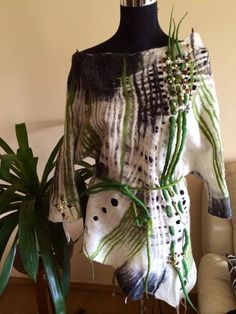 wool felting Green felted tunic | wool felting Do it straight onto white tissue silk to create contours.