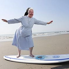 Sister James Dolores, 73, gives her best surfer-girl pose in Stone Harbor, NJ, where her Pennsylvania convent owns a beachfront retreat called Villa Maria by the Sea. Surfing nuns! Nuns beach anyone? :)