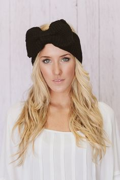 Black Knitted Bow Headband Knitted Head Band Ear Warmer with Large Oversized Knitted Bow BEST SELLER Holi-Dailys. $16.99, via Etsy.