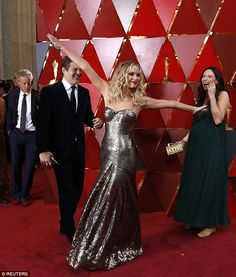 Dazzling: Even on the red carpet the Hunger Games star couldn't help but ham it up