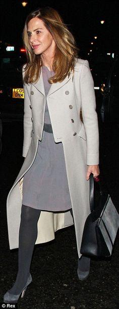 Trinny Woodall looking elegant in a tuxedo cream coat and dusky purple dress