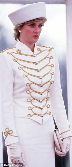 This undated photo shows Diana in a white military-style jacket...
