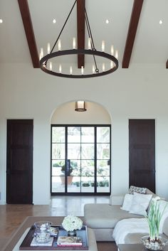"Camille Style's home. Travertine floors throughout that extend onto the terrace. The paint color is ""Mediterranean White"" from Restoration Hardware"