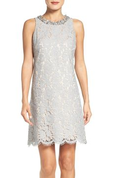 Loving this chic lace shift dress that would be perfect for the mother of the bride. Sparkly jewels illuminate the neckline while an eyelash-fringe scalloped hem falls just above the knees.