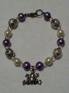 Purple and pearl beads with frog charm