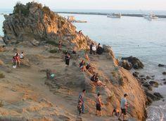 Climbing on the Rocks at Big Corona in Corona del Mar, Newport Beach, California