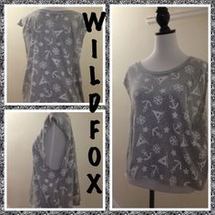 """NWT Wildfox Nautical cap sleeve top ⚓️ Just in. NWT Wildfox gray and white tee. Size large, measures 18.5"""" (bust when laid flat), 22.5"""" from shoulder to hem, scoop neck and over sized arm holes to wear with the """"all the rage"""" bralette, or over a tank or swim suit. Nautical theme ⚓️ very popular this season. 90% cotton, 10% polyester. MSRP $62 plus tax. Wildfox Tops"""