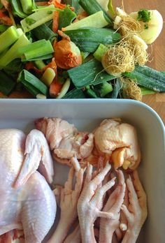 Whole chicken & chickney pieces (necks and feet) with vegetable scraps ready to make our golden honey colored broth Milk and Honey Chicken Broths  NutrientsYouFools.com