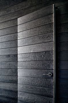 Beautiful burnt cedar shou-sugi-ban panels in Austin TX home, by Aamodt Plumb Architects. Via dezeen.com.