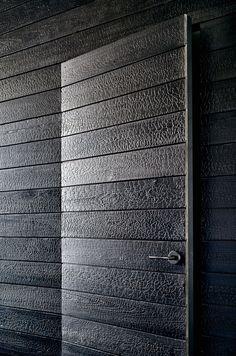 Beautiful burnt cedar shou-sugi-ban panels in Austin TX home, by Aamodt Plumb Architects. Via dezeen.com.