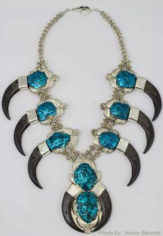 Replica Grizzly Claw necklace, all metal, laser welded with e-coating technique applied in turquoise and black. Photo by Jessie Bennett, Michael Kirk and Elizabeth Kirk, Isleta Pueblo, NM.