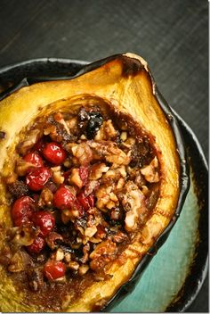 Stuffed acorn squash.  Don't you just LOVE this time of year!!! This looks absolutely delicious.  I wonder how it would be with pecans and cherries