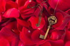 Key with crimson rose petals as a symbol of love by Anastasy Yarmolovich #AnastasyYarmolovichFineArtPhotography  #ArtForHome #vintage