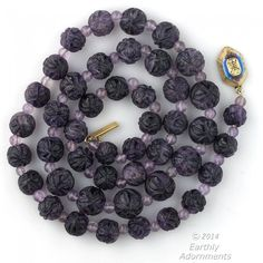 Necklace of beautiful dark purple amethyst beads, Each bead is deep carved in a basket pattern. The beads have somewhat of a matte appearance