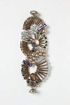 "Fanned Beads Bracelet  $328.00        Magnetic closure      Brass, Swarovski crystal, glass      7""L, 2.5""W      Handmade in Italy         Style #: 25810052    color: assorted"
