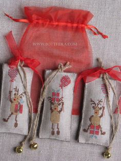 …the little funny reindeers from North Pole… http://bottheka.com/en/cloud-pine-cone-violaii cross stitch, gift tag, cuore e batticuore pattern, linen, cotton thread