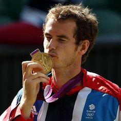 Andy Murray with his gold medal after beating Switzerland's Roger Federer in the final at Wimbledon