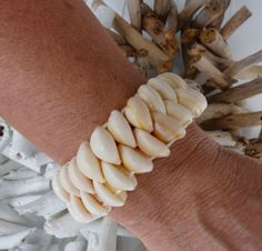this listing is for 1 beachcomber cowrie shell bracelet mermaid bracelet white shells threaded onto secure stretch cord. Beach Bracelets, Shell Bracelet, Shell Crafts, Organza Bags, Sea Shells, Summer Time, Mermaid, Natural Jewelry, Driftwood