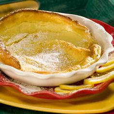 Favorite Dutch Babies recipe. Put on top of a layer of melted butter, sliced fruit, and cinnamon sugar.