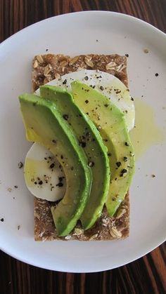 Healthy take to work snack! healthy snack idea: avocado & mozzarella on cracker or toast #healthy #hgeats