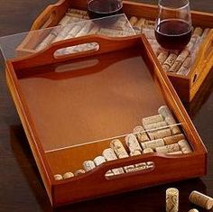 find an old tray... hot glue wine corks* to bottom...   *cut corks in half to lie straight and use fewer