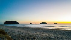 Whangamata Beach sunrise.  The town of Whangamata is sited on the southeast coast of the Coromandel Peninsula in the North Island of New Zealand.