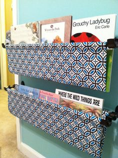 Fabric pocket book shelves using a double curtain rod. Seriously want to do this in the playroom.