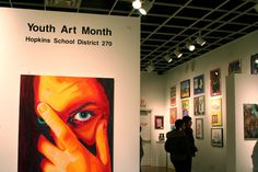 Visitors walk through the Youth Art Month gallery at Hopkins Center for the Arts.